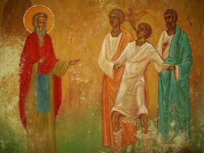 Свети Иоан Рилски изгонва зъл дух от бесноват. Фреска в храм ''Св. Иоан Рилски'' в Стара Планина. България